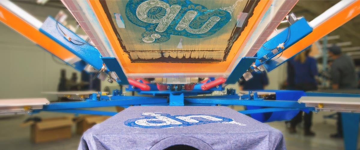 Custom printed t-shirt on a screen print press